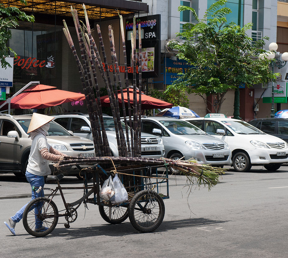 Carting bamboo in the streets of Ho Chi Minh City, Vietnam