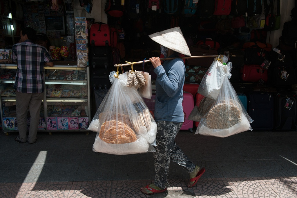 A typical balancing act in Ho Chi Minh City, Vietnam