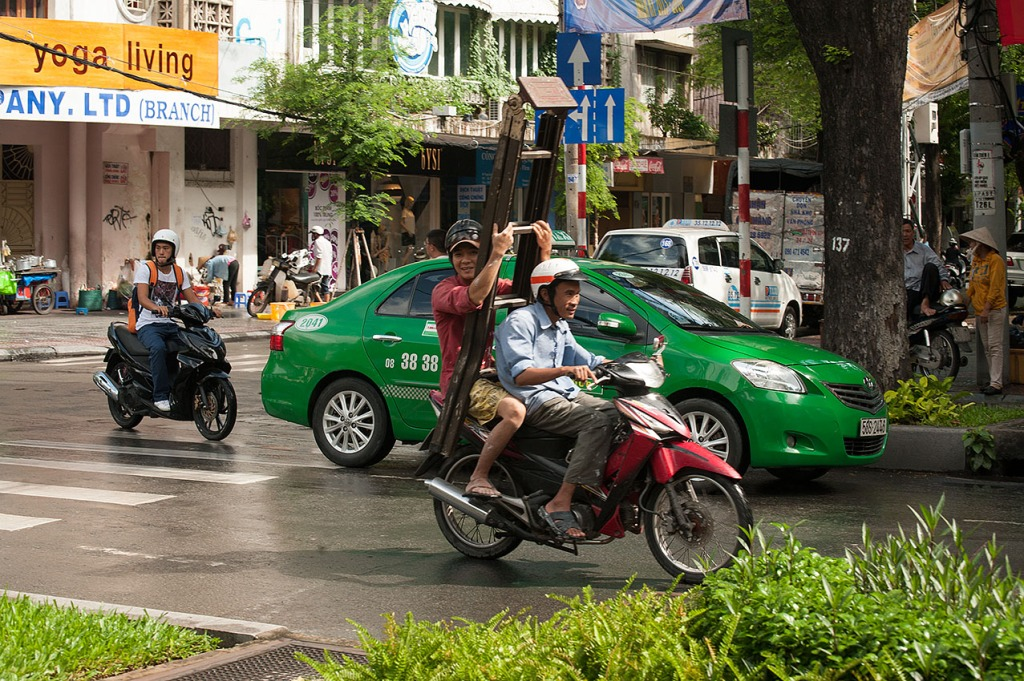 Just another day on a moped - carrying a ladder - in Ho Chi Minh City, Vietnam