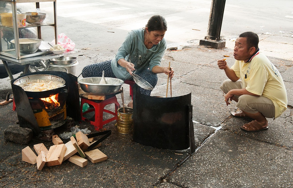 Street food being prepared and enjoyed in Ho Chi Minh City, Vietnam