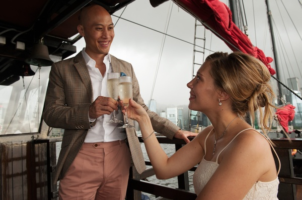 Toasting to marriage and each other, aboard Aqua Luna