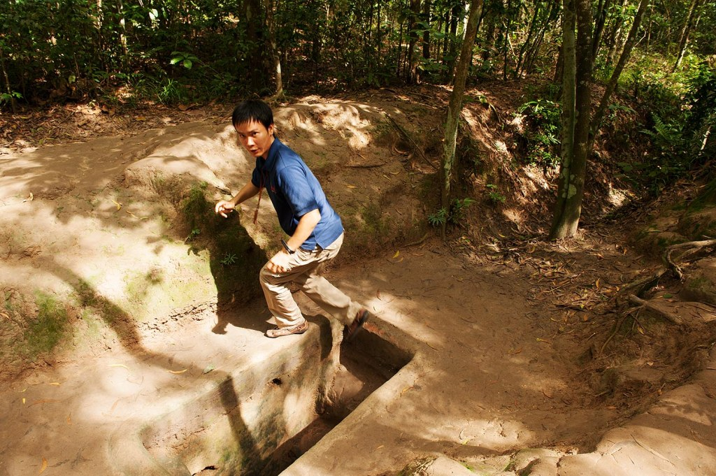 My exceptional private guide, Hai, escaping the Cu Chi tunnels