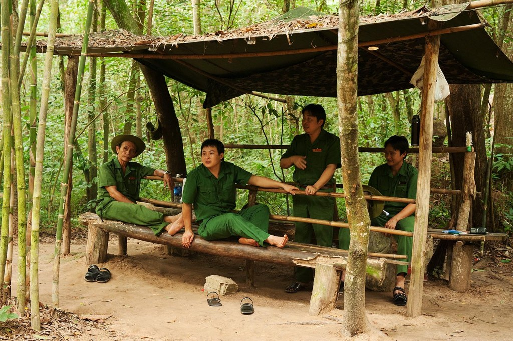 Local workers taking a breather in the hot jungle above the Cu Chi tunnels