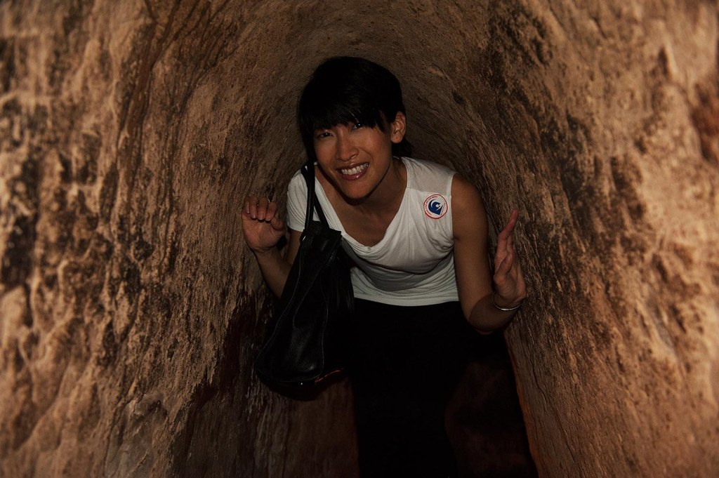 Yours truly, getting a brief, back-breaking sample of what it was like to make one's way through the Cu Chi tunnels