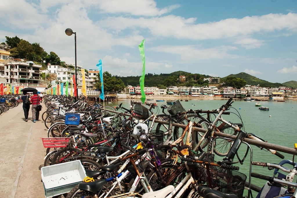 Yung Shue Wan pier on Lamma Island, brimming with bikes as the main wheeled form of transport