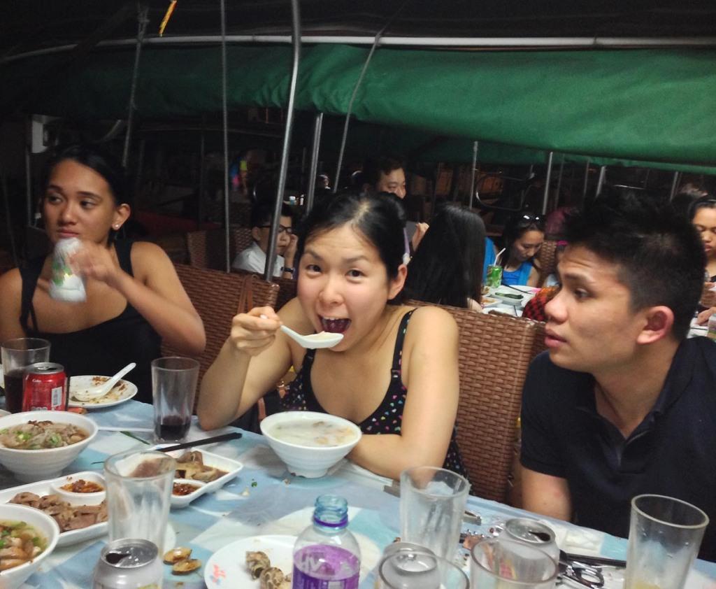 Mal happily slurping soup at Shun Kee