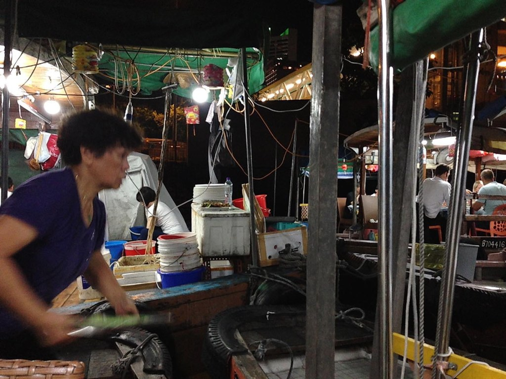 Our super-efficient waitress, shepherding food to multiple dining boats at Shun Kee
