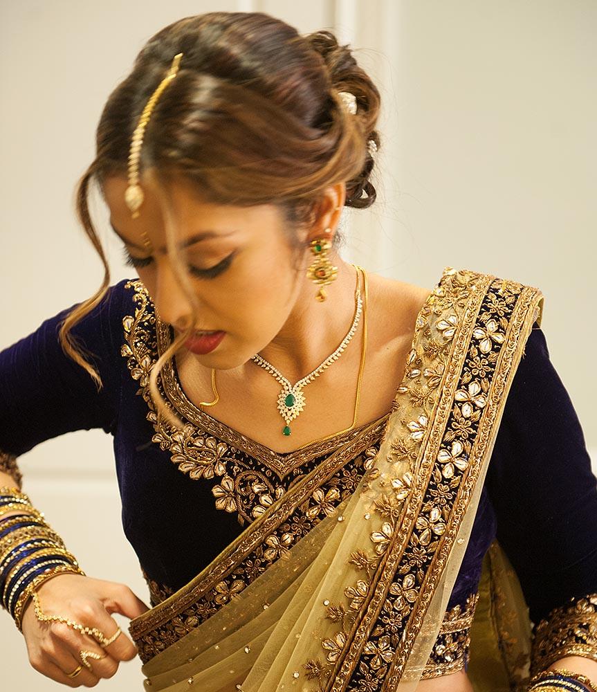 Divya, putting final touches on her elaborately gorgeous, custom-designed wedding reception sari