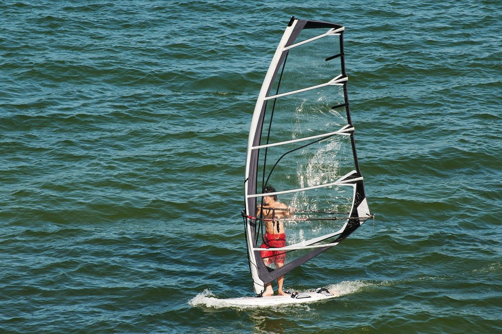 Windsurfing is a popular draw at Stanley Main Beach