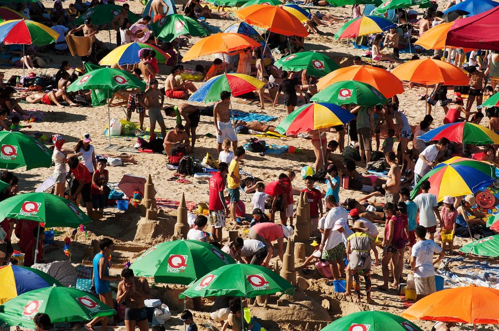Colorful but sometimes oppressive crowds on Stanley Main Beach (although the ambitious sand castle is  a nice touch!)