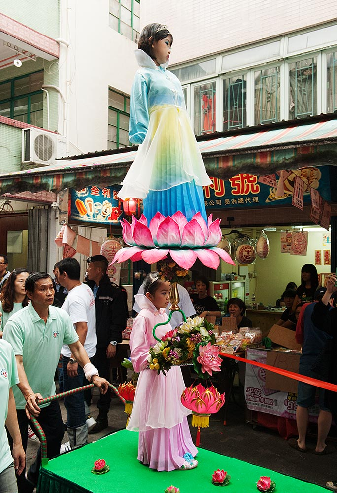 The Piu Sik (Floating Colours) Parade, during which children appear to 'float' through the narrow streets of Cheng Chau island