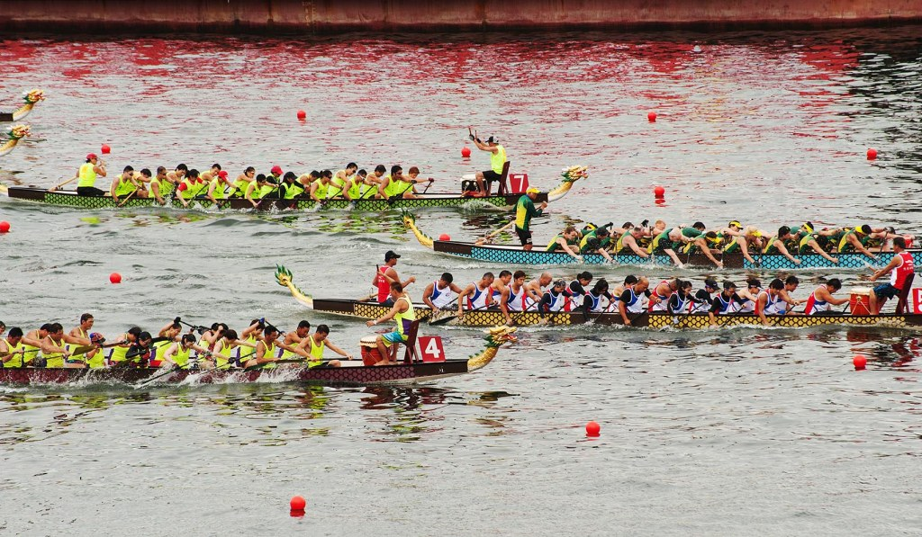 Fierce dragon boat competitors race toward the finish line on Victoria Harbour