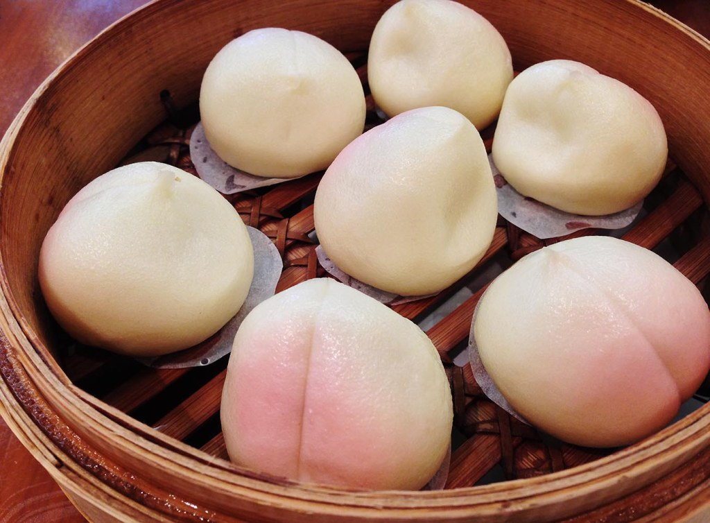 Peach-shaped, lotus-seed-paste filled steamed sweet buns (which I thought were pretty, 'til Mark pointed out the resemblance to diaper rash)