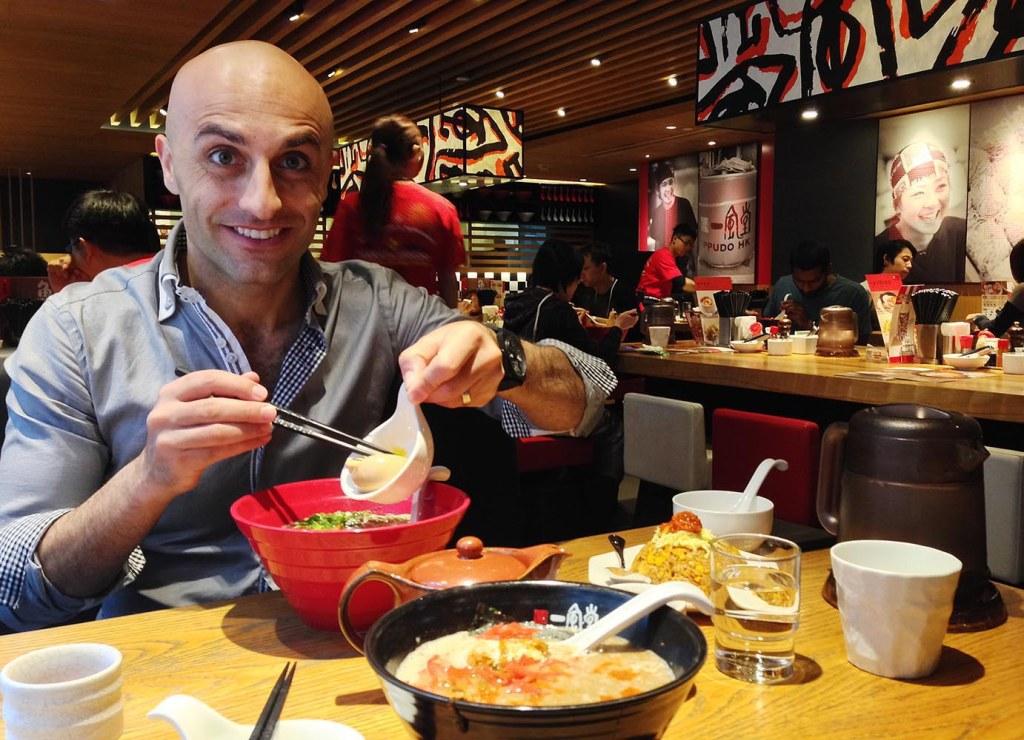 Mark enjoying Ippudo's classic pork ramen - with extra egg, of course