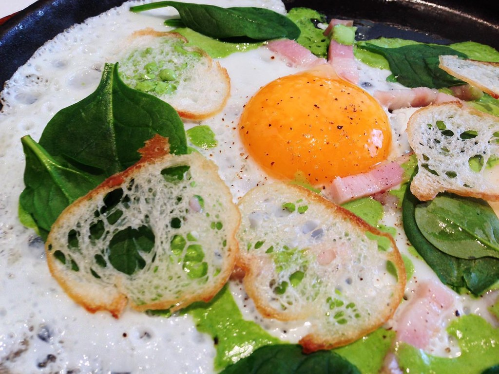 Sunny side up egg, with free range bacon, greens, croutons, and watercress sauce - prepared tableside at The Principal