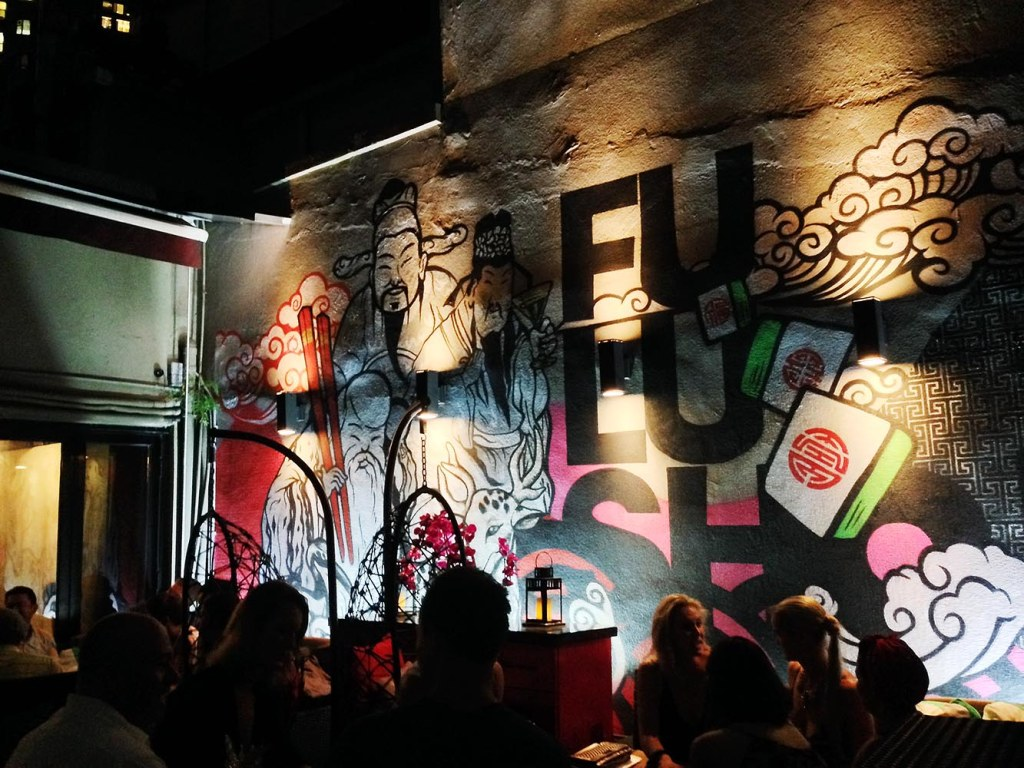 Street-inspired wall art at cheeky eatery/rooftop lounge Fu Lu Shou