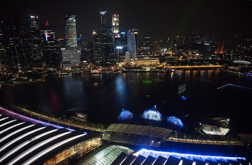 View over Marina Bay during the nightly Wonder Full light and water show in glitzy Singapore