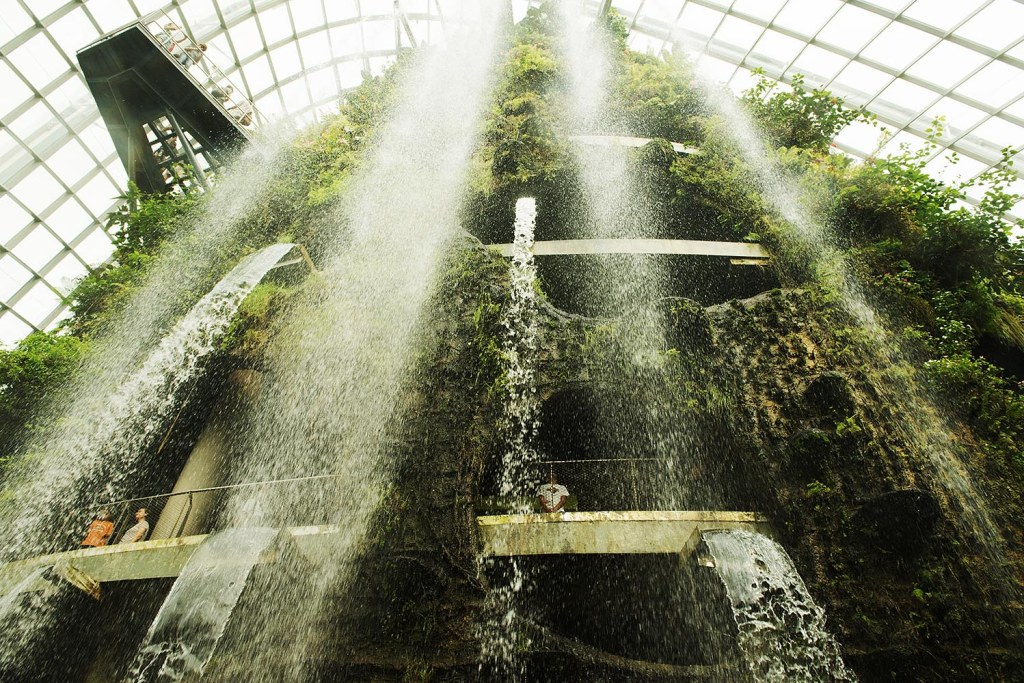 The welcoming waterfall of the Cloud Forest dome at Gardens by the Bay - the closest you'll get to a much-needed mid-day shower away from home or your hotel (just don't actually step into it, probably a bit of a security flag)