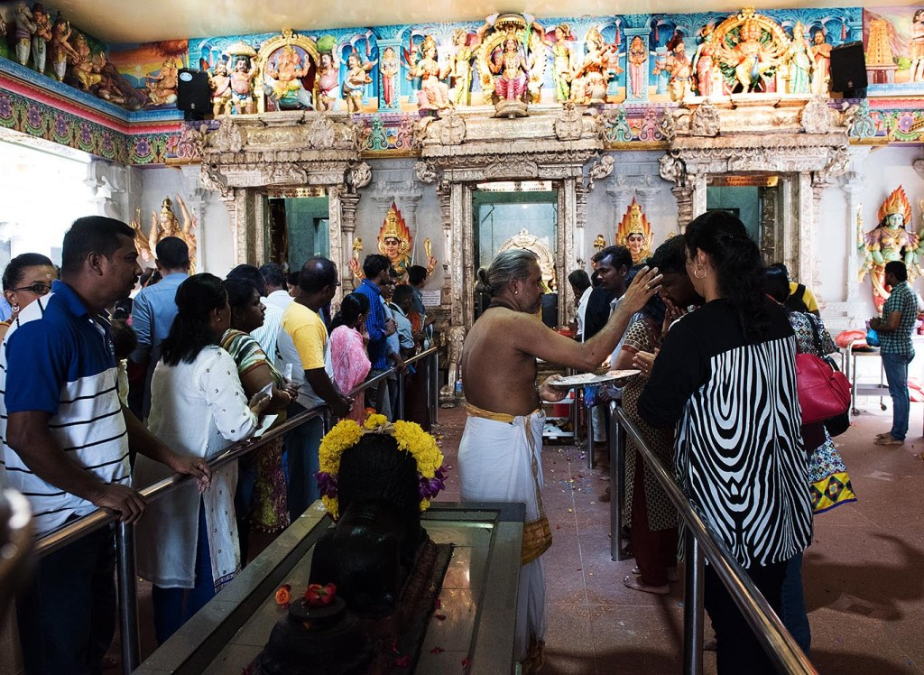 Temple-goers get blessed inside the main hall