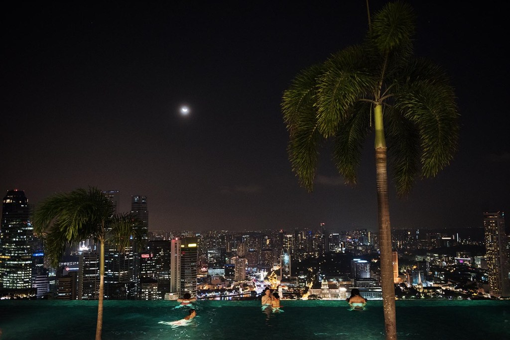 Swimming in the pool at night feels extra-luxurious, as you drift through underwater light beams, gaze up at palm trees and the light of the moon, and absorb the city skyline