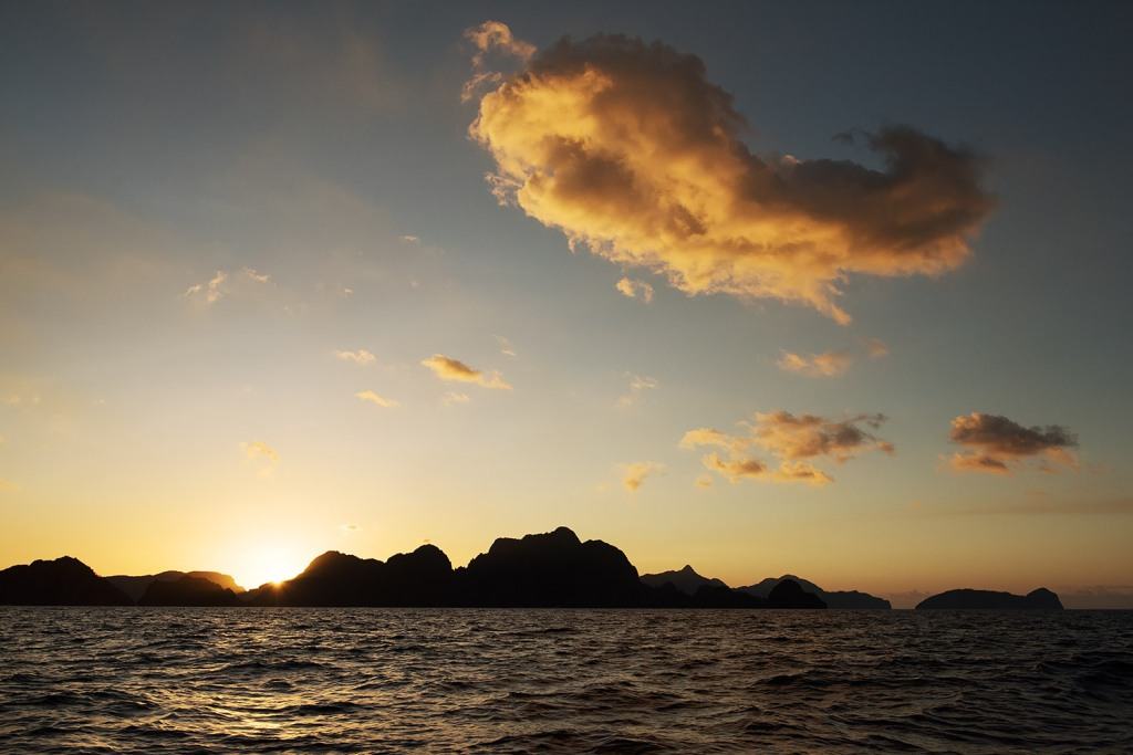 El Nido's iconic landscape of limestone rock formations, silhouetted at sunset