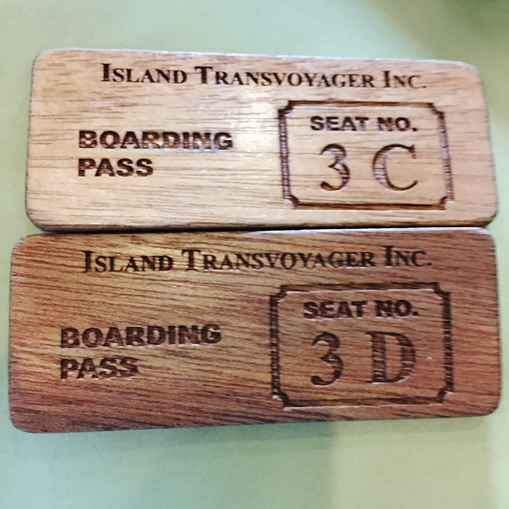 Throwback wooden boarding passes for the flight connecting Manila to El Nido