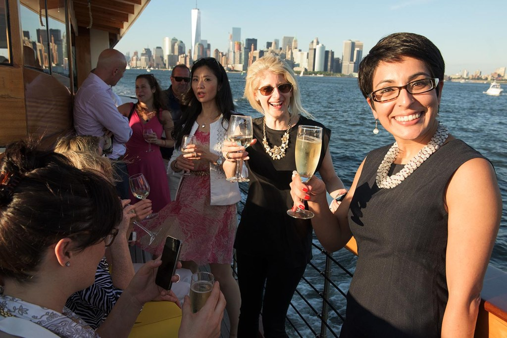 Michele and Diksha enjoy bubbly while aboard the Manhattan