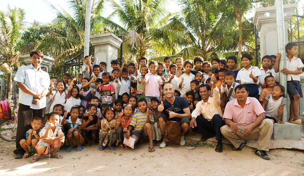 Mark, with the awe-inspiring Nu Tarth and the beautiful students at his school in Siem Reap, Cambodia