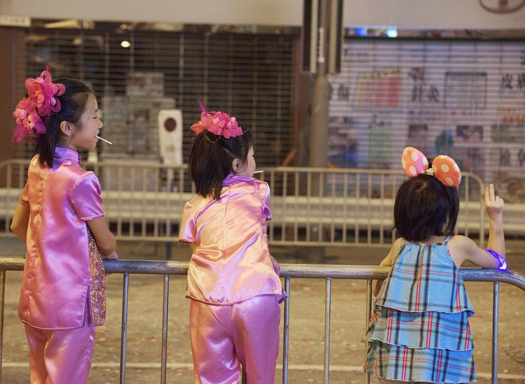 Little spectators at the Fire Dragon Dance