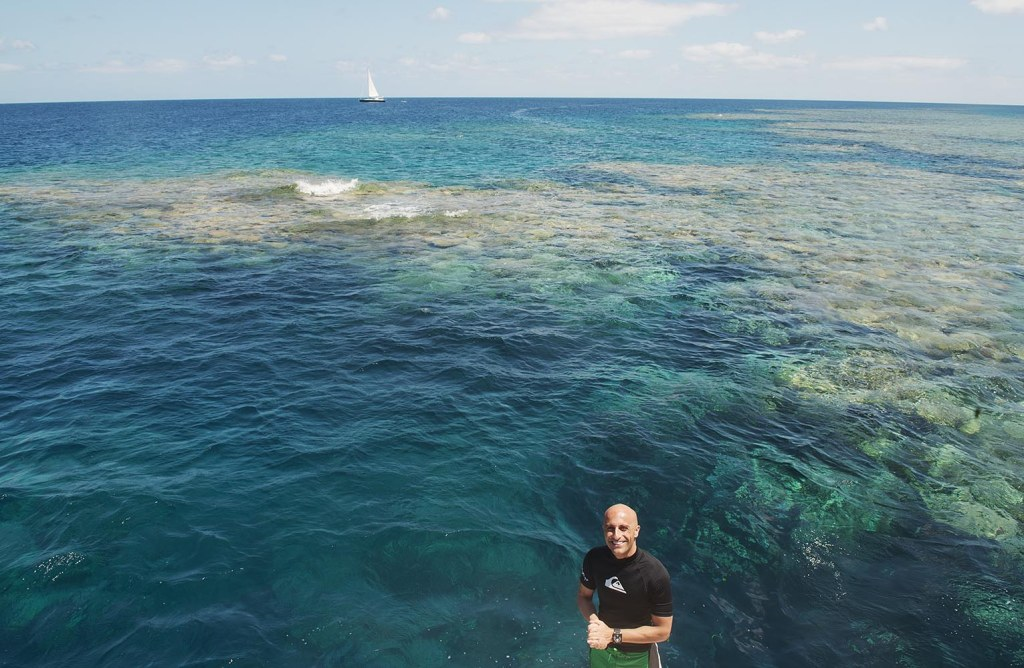 Mark, just before diving into the depths of the sea surrounding the Great Barrier Reef