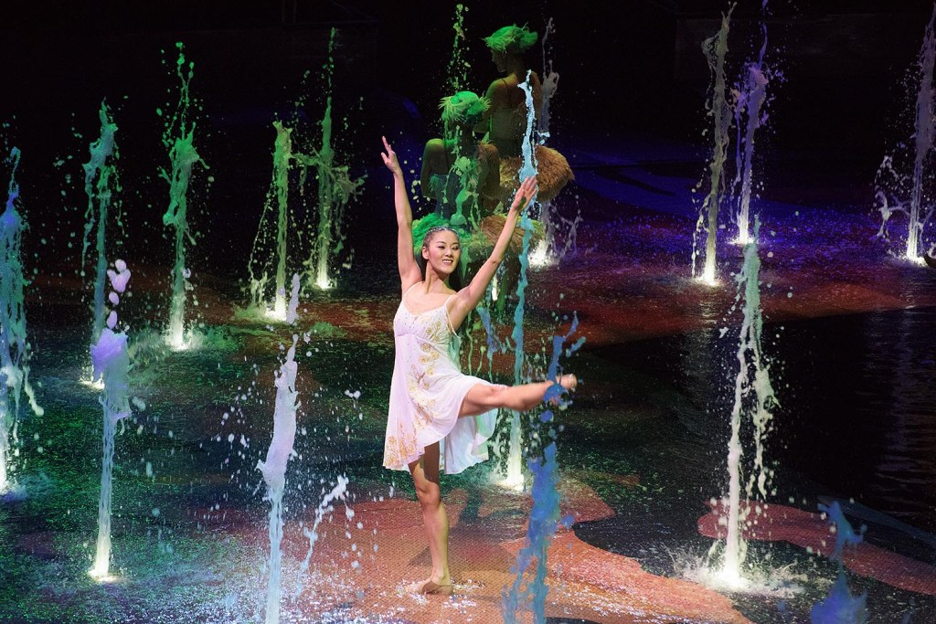 Like Cirque du Soleil, House of Dancing Water incorporates elements of contemporary dance into its performance. Here, the lead female performer lights up the stage