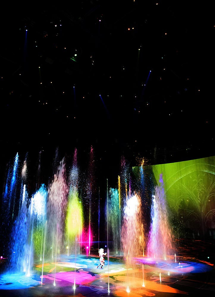 The apparent evil captor 'queen' scopes out her kaleidoscopic geyser landscape in House of Dancing Water