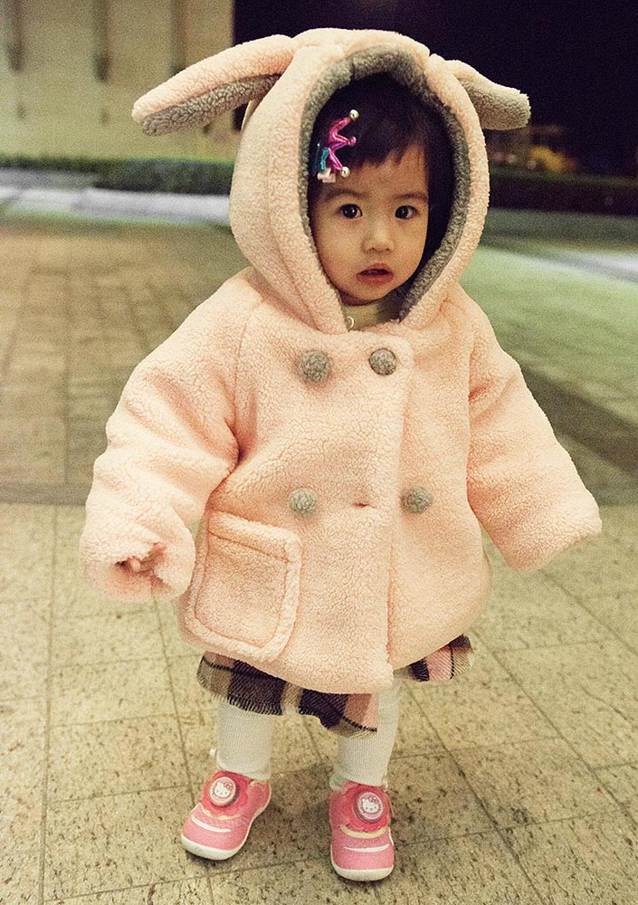 Couldn't resist snapping this adorable little girl, bundled up for a cool evening out and about in Macau