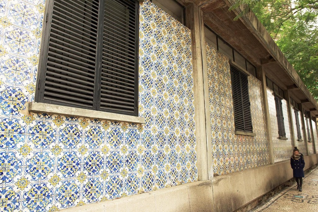 Classic Portuguese blue and white tiles cover buildings in the historic district of Macau