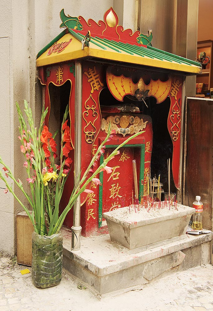 A Chinese shrine on the street near the ruins of St. Paul's