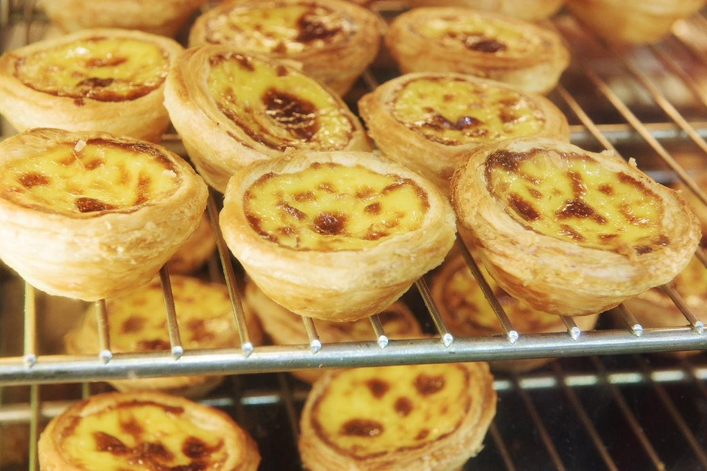 Caramlized, flaky crust, Portuguese-style egg tarts - a local delicacy and not to be missed!