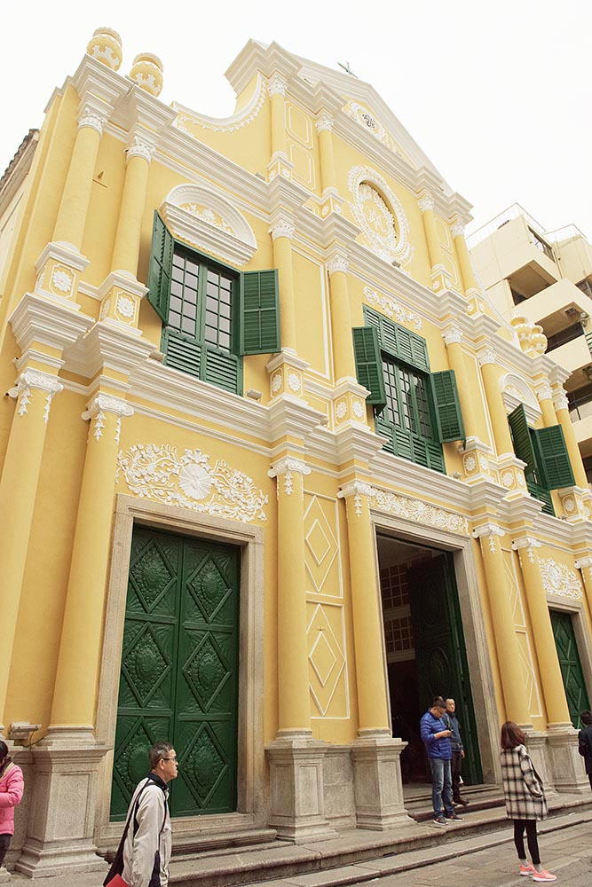 Saint Dominic's Church, evoking Macau's colonial past with its characteristic yellow, green, and white architecture and shuttered windows