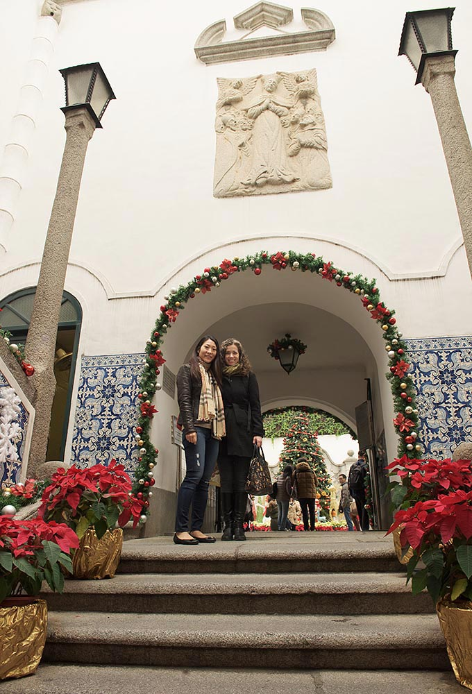 Ginny and Jen bask in the natural light filling the entrance to the Civic and Municipal Affairs Bureau building, just across from Senado Square
