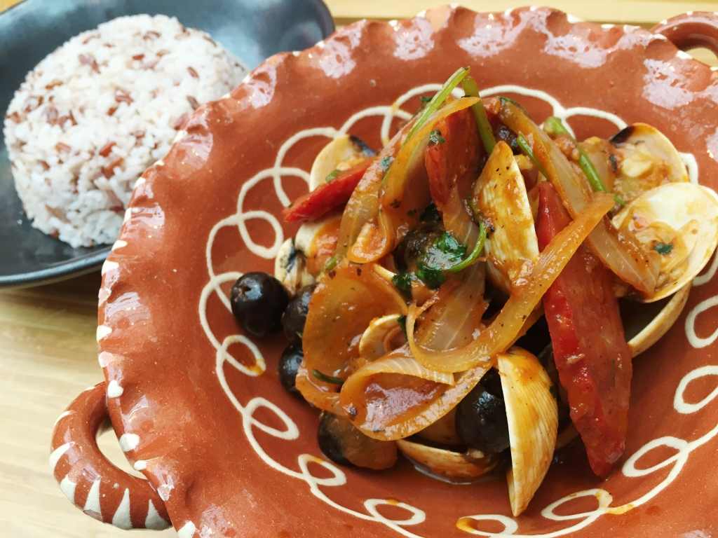 A classic Portuguese-inspired dish, clam and chorizo stew, cooked in a catalpa